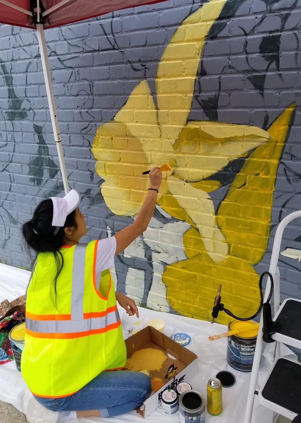 Muralist painting daffodil