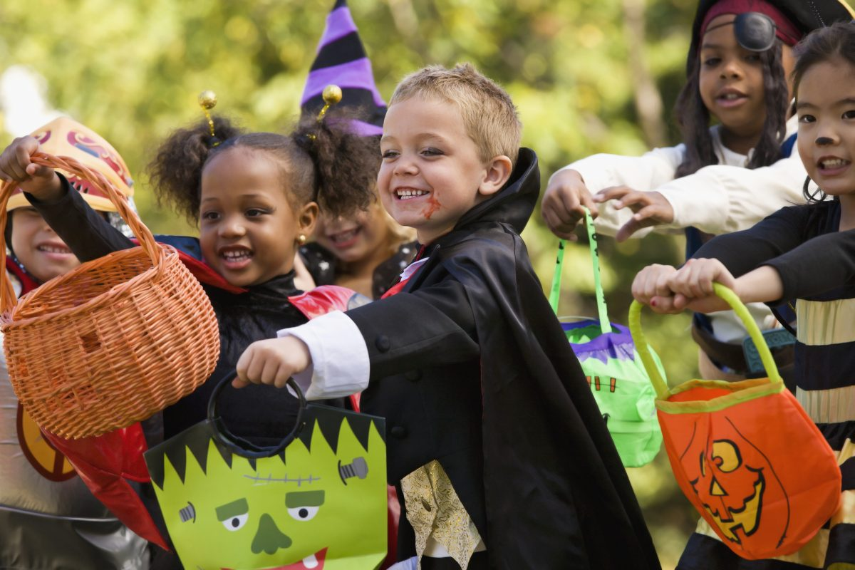 children dressed in Halloween costumes