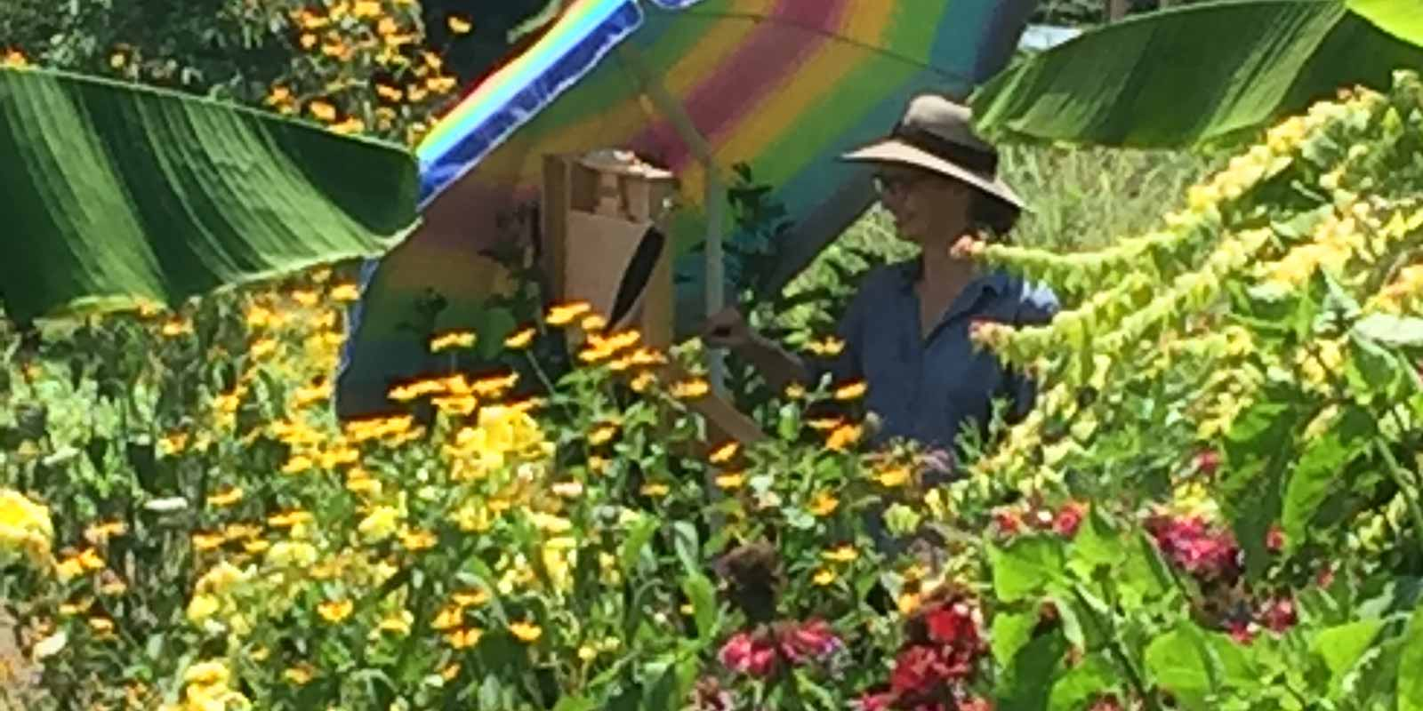 Artist painting in the floral garden